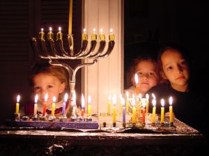 kids-behind-chanukah-menorah-414244-m.jpg