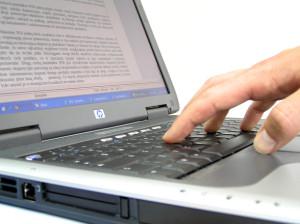 work-at-laptop-1547527-300x224