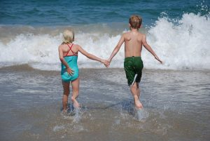 brother-and-sister-into-the-ocean-2-1430015-300x201